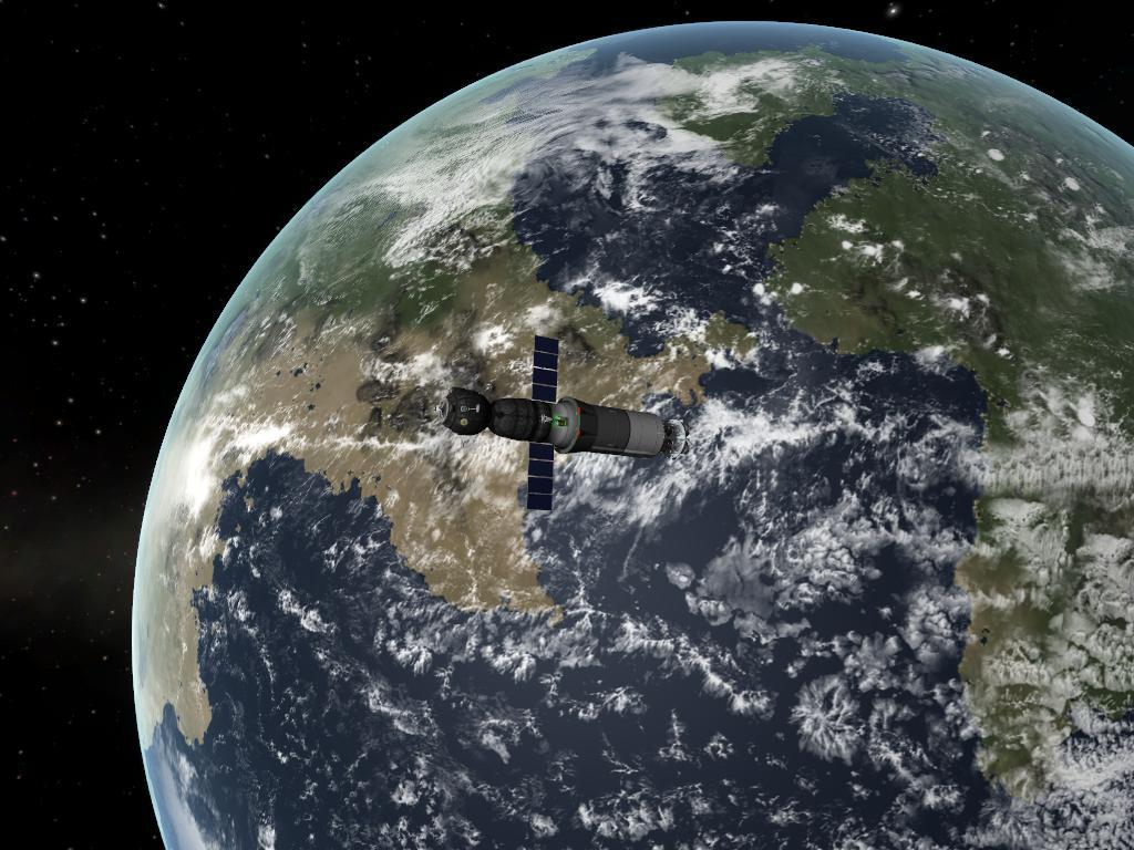 La capsule Soyouz, encore accrochée au 3ème étage de sa fusée, effectue des manœuvres de rendez-vous.